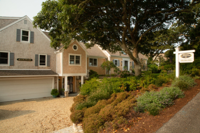 Front exterior and driveway of new home in Chatham, Mass