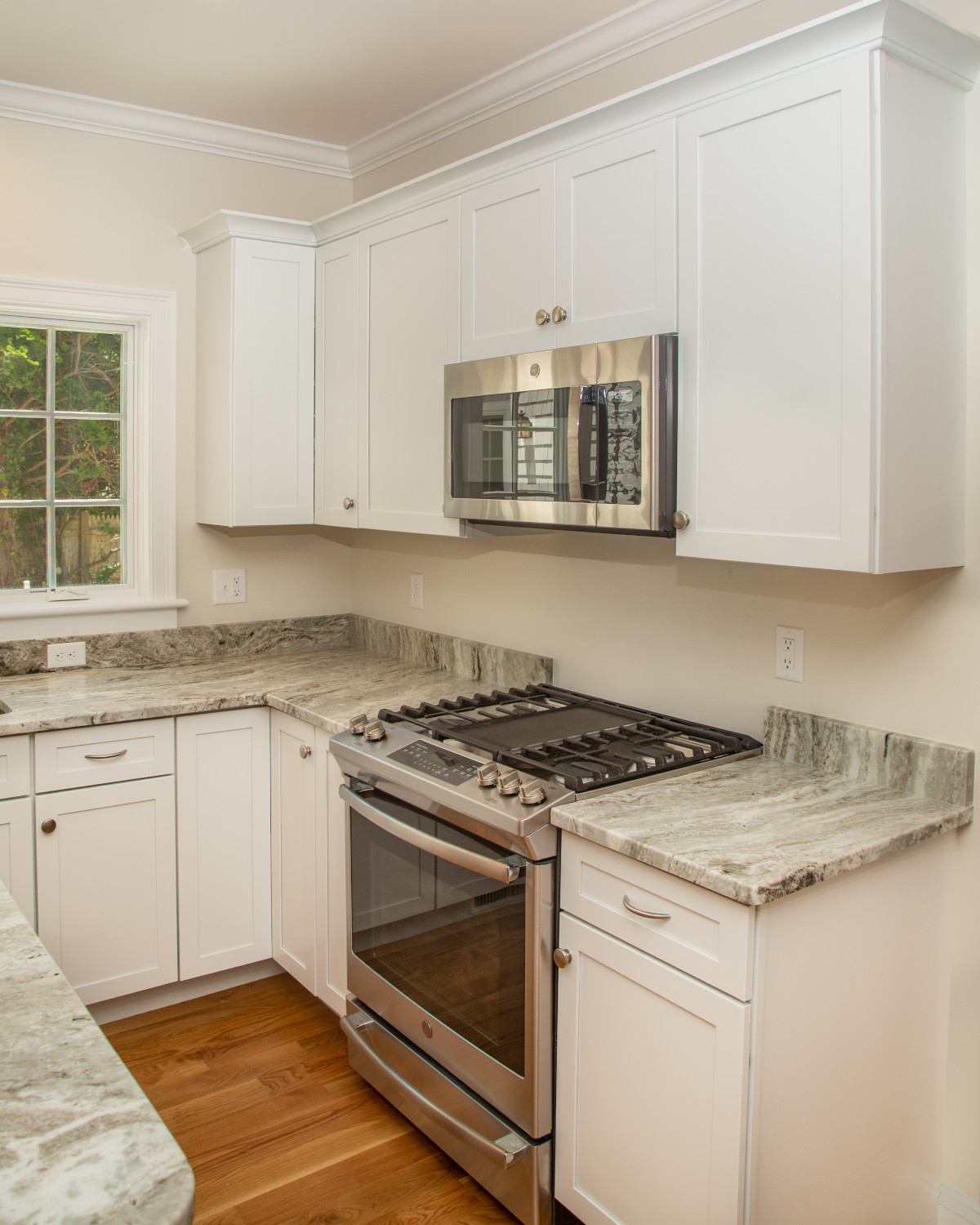 View of kitchen counter and appliances in new home