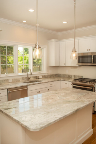 Center island in kitchen of new home