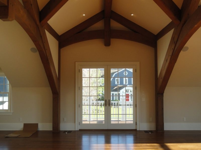 Exposed beam ceiling and hardwood floor in newly remodeled home