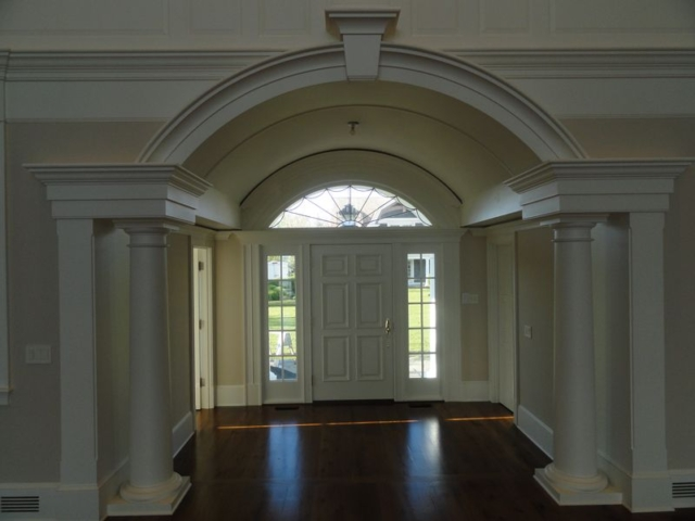 Front entry way with columns, interior view