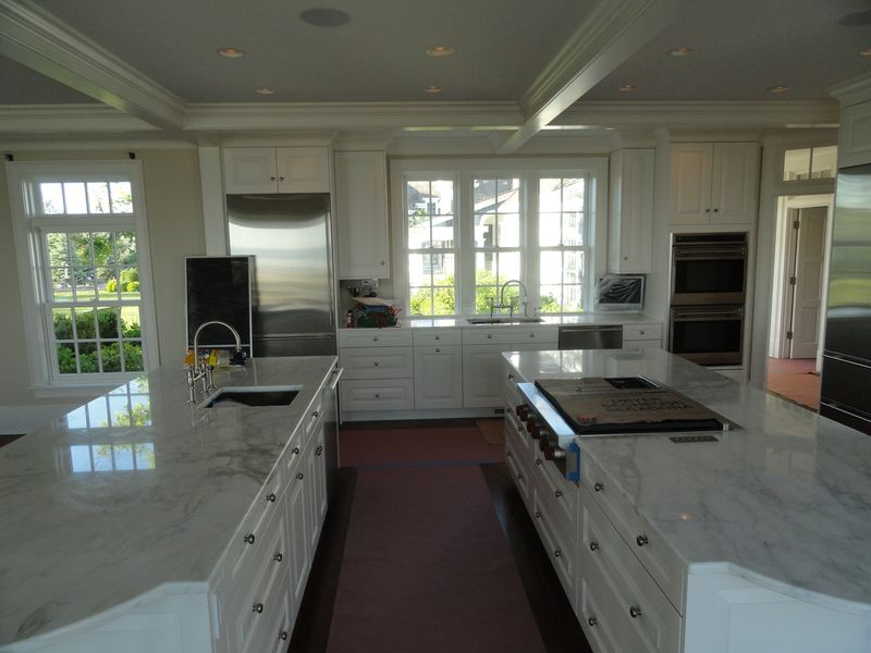 Newly remodeled kitchen with marble countertops
