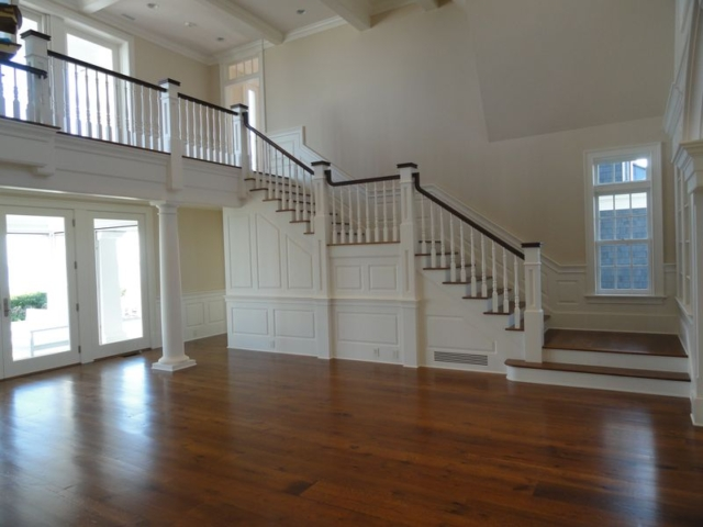 Staircase and hardwood floors of remodeled home
