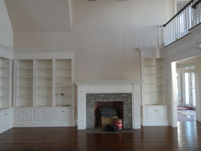 Stone fireplace, built in cabinets, hardwood floor in remodeled home