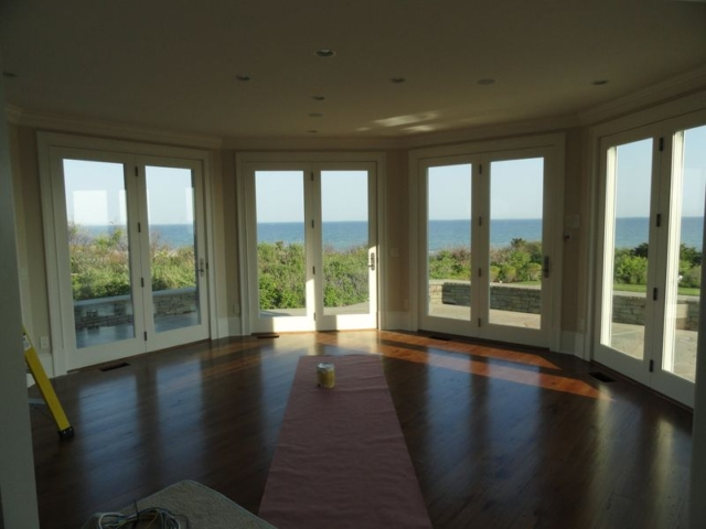 Four sets of French doors opening to patio with ocean view