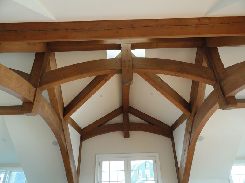 Closeup of exposed beam ceiling in remodeled home