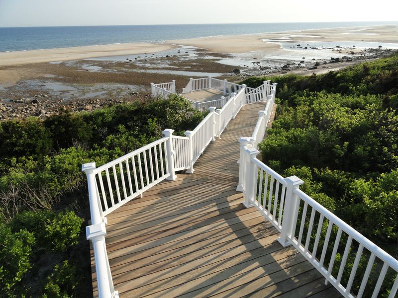 Long wooden stairway to beach with multiple landings