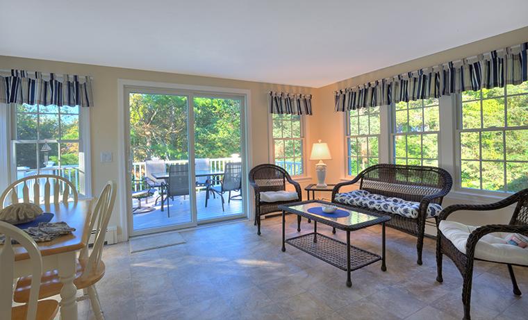 Finsshed furnished sunroom with tile floor